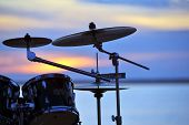 image of drum-set  - Photo drum set against a beautiful sunset - JPG