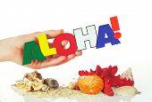 Female Hand Holding Colorful Word Aloha