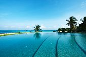 foto of infinity pool  - Luxury swimming pool in the tropical hotel - JPG