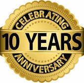 stock photo of rosettes  - Celebrating 10 years anniversary golden label with ribbon - JPG