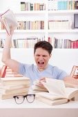 Angry Student  Surrounded By Books  Throws A Book