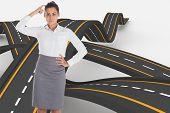 Focused businesswoman against bumpy road background