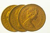 Three one pound coins