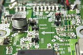 image of capacitor  - Macro of a Circuit Board With Chips and Capacitor - JPG