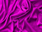Luxurious deep satin folded fabric, useful for backgrounds