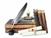 stock photo of inkpot  - Old books candle in candlestick feather in inkpot and scroll with stamp - JPG