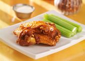 bbq buffalo chicken wings with ranch dip and celery