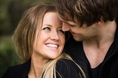 Romantic, tender moment of a young attractive couple. Cheerful girl close up portrait