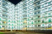 stock photo of public housing  - Public housing in Hong Kong at night - JPG