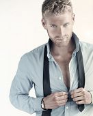 picture of undressing  - Sexy portrait of a young confident businessman - JPG