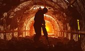 stock photo of mines  - Silhouettes of workers in the mine - JPG