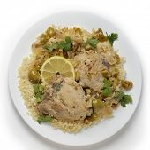 Chicken thighs cooked with olives, onions and orange and lemon juice, served over a bed of couscous