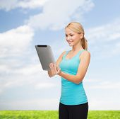 sport, excercise, technology, internet and healthcare - sporty woman with tablet pc