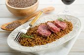 slice sausage with lentils