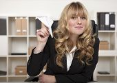 Playful Businesswoman With A Paper Plane