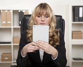 Young Businesswoman Using A Tablet At Work