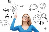 education, school, people and gesture concept - smiling woman in glasses pointing finger up
