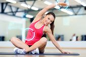sport, fitness, training, technology and lifestyle concept - smiling young woman exercising in gym