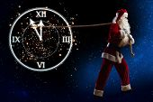 Santa Claus and clock showing five minutes to twelve