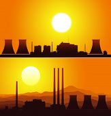 Silhouettes of a nuclear power plants at sunset.