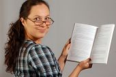 Smiling Woman In Glasses With A Book