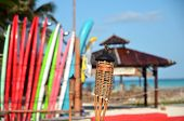 Stack Of Surfboards And Lamp