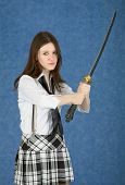 Girl - Teenager Menacingly Brandishes A Sword