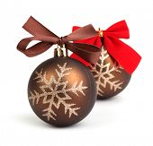 Christmas balls with bow in chocolate tone.