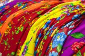 foto of traditional attire  - Detail of colorful traditional gipsy dresses fabrics with floral patterns - JPG