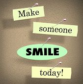 Make Someone Smile Today words on papers in a saying or quote pinned to a bulletin board