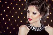 Beautiful Brunette Young Woman. Fashion Girl Model Over Bokeh Lights Background