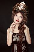 Fashion Russian Girl Model In Exclusive Design Clothes On Manners Old-slavic. Close-up Portrait.