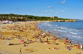 TARRAGONA, SPAIN - AUGUST 5: Vacationers in Arrabassada Beach on August 5, 2014 in Tarragona, Spain. Tarragona, in the famous Costa Daurada, has several urban beaches like this, frequented by local