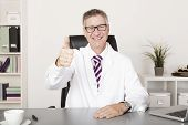 Happy Medical Doctor Showing Thumbs Up