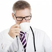 Over-thinking Male Doctor While Sipping Coffee
