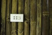 Plugs And Switch On The Bamboo Wall