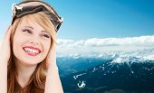 people, sports and happiness concept - smiling teenage girl in snowboard goggles