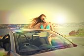 beautiful woman in a cabriolet