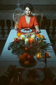 Woman At The Festive Table.