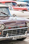 HAVANA, CUBA - DECEMBER 14, 2014 : Vertical image of a group of vintage american cars