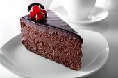 picture of dessert plate  - Delicious chocolate cake on plate on table on light background - JPG