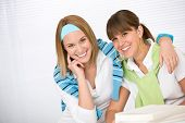 Student At Home - Two Young Woman Study Together