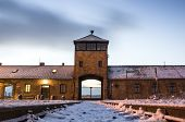 stock photo of nazi  - Main gate to nazi concentration camp of Auschwitz Birkenau Poland