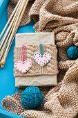 Old Notebook With Knitted Cover With Felt Heart Next To The Bright Tangle Of Yarn, Knitting And  Kni