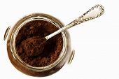 Ground coffee in a glass jar