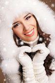 Portrait of a beautiful brunette in the winter.
