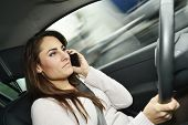 Woman talking on phone while driving
