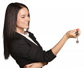 Beautiful girl broker holding sale house key.