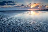 foto of tide  - sunrise over North sea coast at low tide Holland - JPG