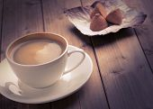 stock photo of truffle  - cup of coffee and a chocolate truffles - JPG